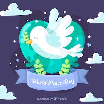 フラットなデザインの平和の日鳩の飛行