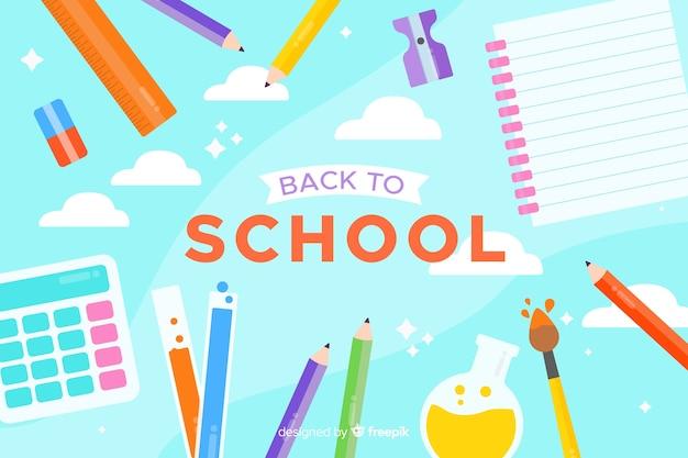 青色の背景のフラットなデザインと学校構成に戻る