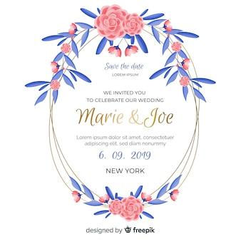 青い葉の結婚式の招待状とピンクの花のフレーム