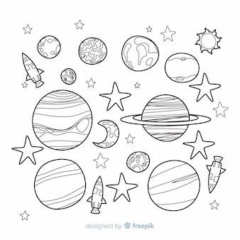 Ручной обращается коллекция планет в стиле каракули