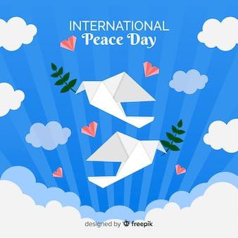 折り紙の鳩と平和の日の背景