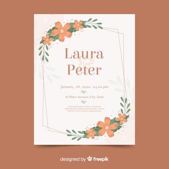 フラットなデザインで花のフレームと結婚式の招待状