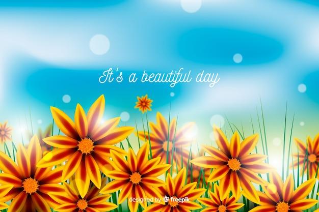 心に強く訴える引用と色とりどりの花の背景