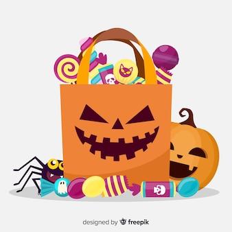 Счастливый хэллоуин со сладостями в бумажном пакете