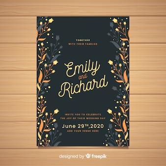 花のフレームと黒の結婚式の招待状