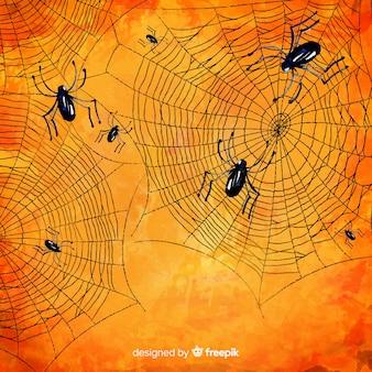 ハロウィーンの背景のクモと不気味なクモの巣