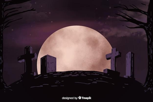 墓地の丘を背景に満月の夜
