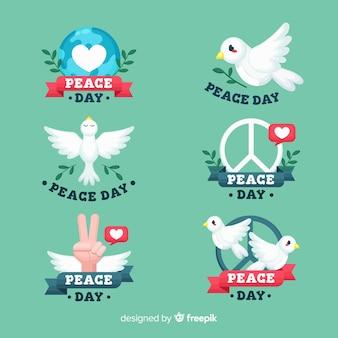 フラットなデザインの平和日バッジコレクション