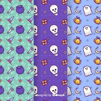 手描きの青の色合いのハロウィーンのシームレスパターン