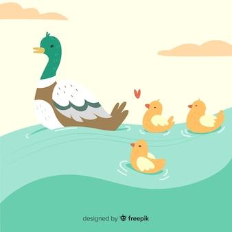 平らな母鴨と水にかわいいアヒルの子