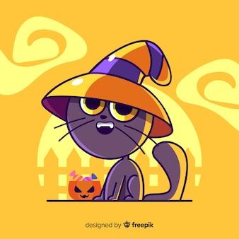 黄色の背景にかわいい魔女猫
