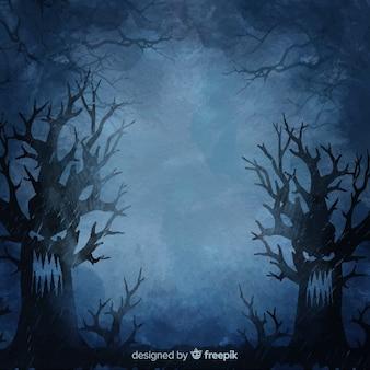 夜のハロウィーンの背景で怒っている木