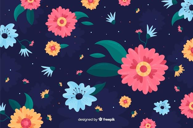 青色の背景にピンクの花をクローズアップ