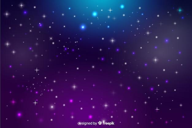 グラデーションの夜空にぼやけた星
