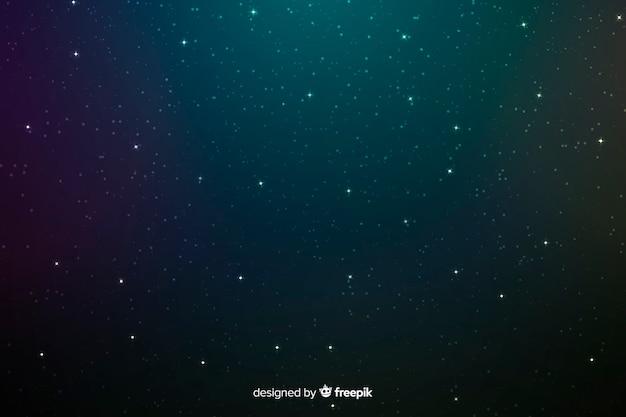 真夜中の暗い青と緑の星の背景