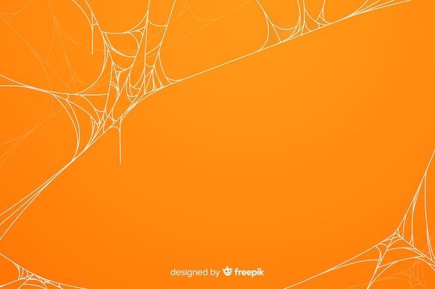 オレンジ色のハロウィーンクモの巣の背景