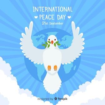 フラットなデザインの鳩と平和の日の概念