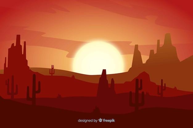 グラデーション色の夕日の砂漠の風景