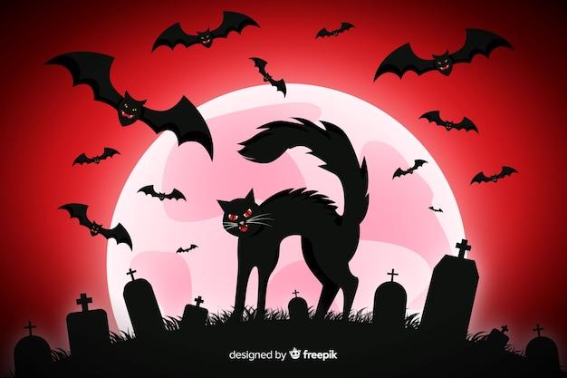 Черная кошка и летучие мыши на фоне кладбища