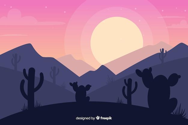 夕日とサボテンの砂漠の風景