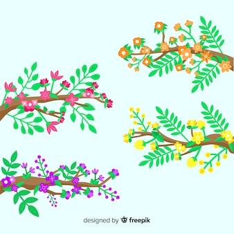 Плоские красочные цветочные ветви на зеленом фоне