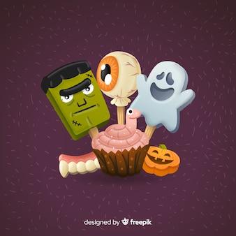スティックにハロウィーンの生き物とカップケーキ
