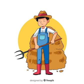 Фермер работает на улице с сеном