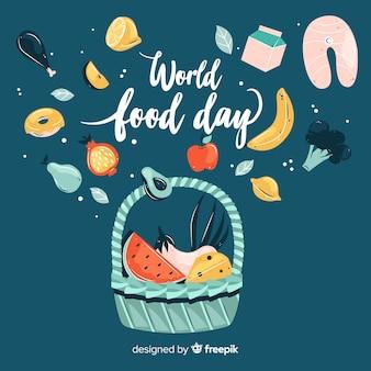 Ручной обращается всемирный день еды на синем фоне