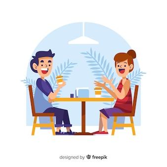 コーヒーを飲みながら話している人々