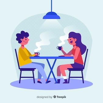 コーヒーを飲みながら会話する人々