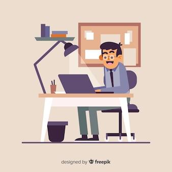 机に座って働く人