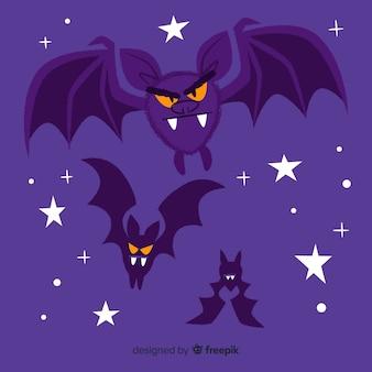 夜に飛んでいる怒っているコウモリ