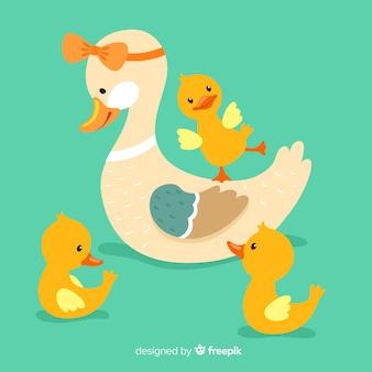 Милая и маленькая мама утка и утята