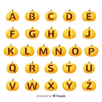 文字のアルファベットが刻まれたハロウィーンカボチャ