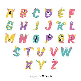 ハロウィーンモンスターとアルファベットの白い背景