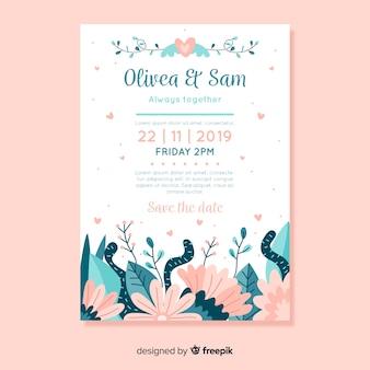 花を持つフラットなデザインの結婚式の招待状のテンプレート