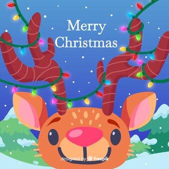 手描きクリスマスの背景にかわいいトナカイ