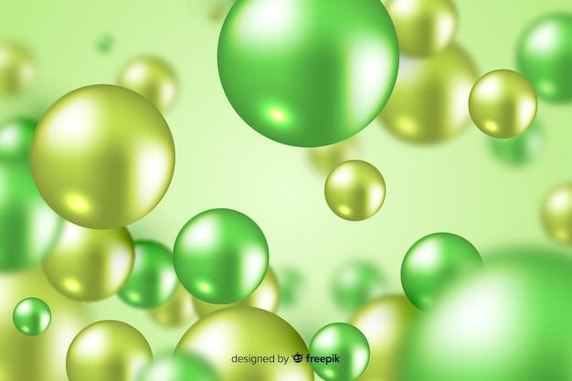 現実的な流れる緑の光沢のあるボールの背景