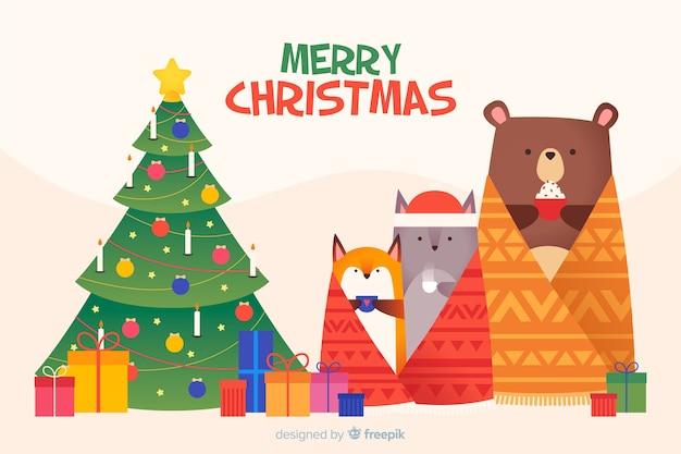 動物とフラットクリスマス背景