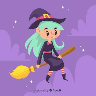 Милая ведьма с длинными волосами, опираясь на метлу