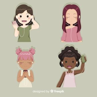 楽しんで、音楽を聴く若い女の子