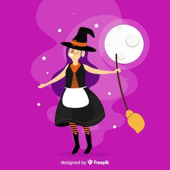黒のドレスで笑顔のハロウィーンの魔女