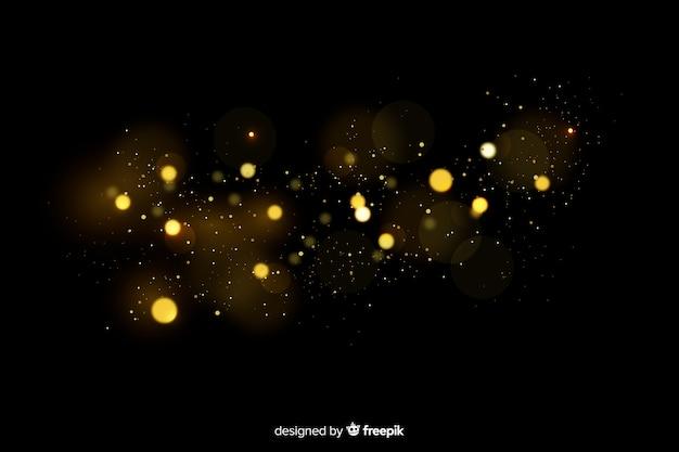 黒の背景を持つ浮遊粒子効果