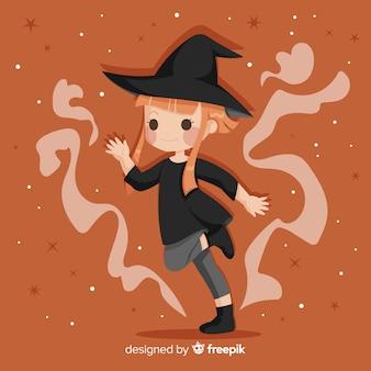 オレンジ色の髪のかわいいハロウィーン魔女
