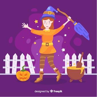 Милая хэллоуин ведьма с тыквой и плавильным котлом