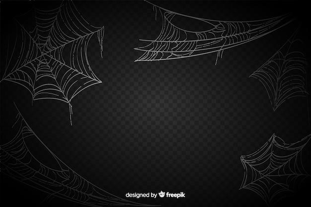 黒の背景に現実的なクモの巣