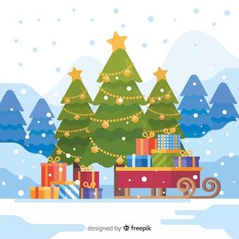 クリスマスツリーの背景にプレゼント、そり