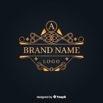 エレガントな黄金の装飾的なロゴ