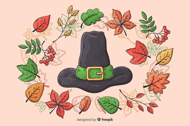 魔女の帽子と手描きの感謝祭の背景