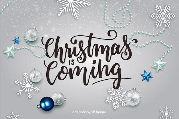 Рождественская надпись с реалистичными элементами